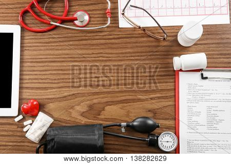 Medical concept. Medical manometer and a stethoscope on wooden background