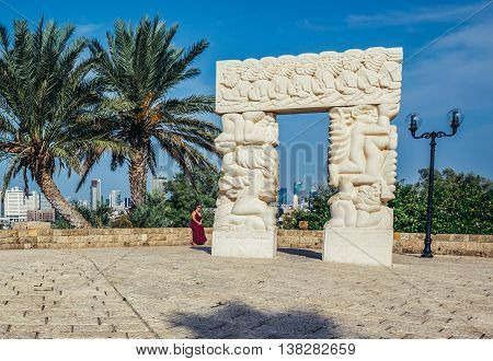 Tel Aviv Israel - October 20 2015. Woman sits next to Statue of Faith created by Daniel Kafri in Abrasha park