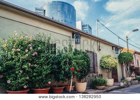 Tel Aviv Israel - October 20 2015. Small house with building of Trade Tower on background in historic Neve Tzedek district (lit. Abode of Justice) in southwestern part of Tel Aviv
