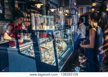Tel Aviv Israel - October 20 2015. People buys ice cream in cafe bar in historic Neve Tzedek district (lit. Abode of Justice) of Tel Aviv