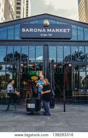 Tel Aviv Israel - October 21 2015. People stands in front of one of the entrances to pupular covered public market called Sarona Market in Tel Aviv