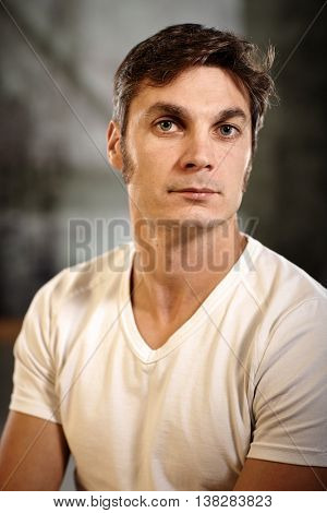 Portrait of casual young man looking at camera.