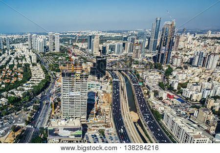Tel Aviv Israel - October 21 2015. Aerial view of Ayalon Highway and Ramat Gan district from 49th floor of Circular Tower one of three skyscrapers of Azrieli Center complex in Tel Aviv