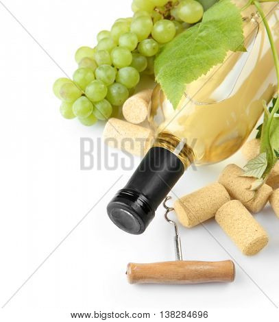 White wine with grapes, isolated on white