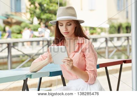 beautiful woman using tablet on lunch break in the cafe