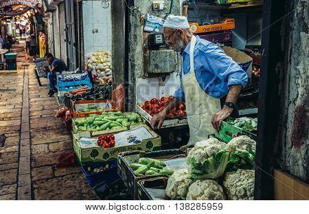 Jerusalem Israel - October 22 2015. Old man sells vegetables on Arab baazar located inside the walls of the Old City of Jerusalem