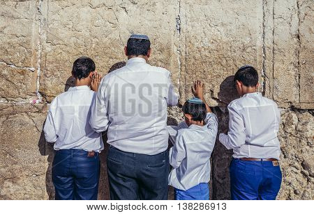 Jerusalem Israel - October 22 2015. Jews prays in front of ancient limestone wall known as Wailing Wall in the Old City of Jerusalem