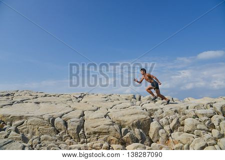 Young man doing run in outdoors