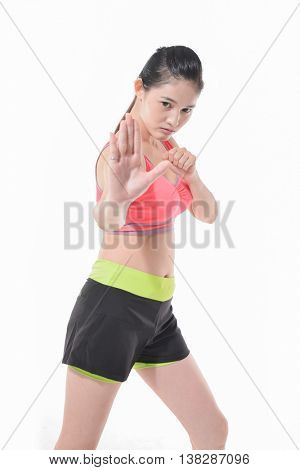 Portrait of fit young woman in boxing stance over white background