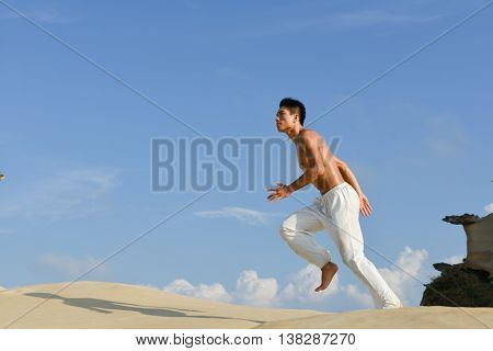 Healthy lifestyle concept -Young man doing run in outdoors