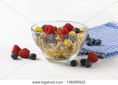 bowl of cereals and berry fruit and checkered napkin