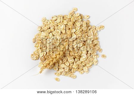 pile of oat flakes on white background