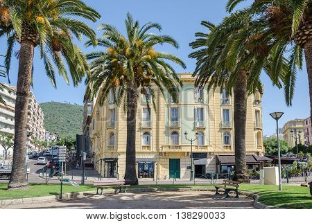 Ajaccio France - May 27 2016: View of one of the central streets of capital city of Corsica - Boulevard Albert 1er with palm trees and house number 10.