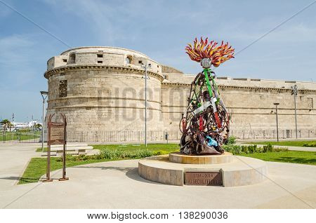 Civitavecchia Italy - May 28 2016: A view of Fort Michelangelo with a memorial monument to the Carabinieri the national gendarmerie of Italy