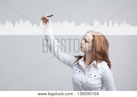 Young woman working with graph chart. Future technologies for busines, stock market concept.