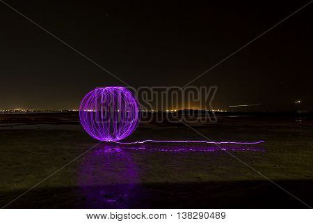 Purple orb light painting with long tail