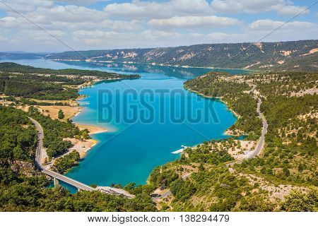 Picturesque lake with turquoise water among wooded hills. Canyon of Verdon, Provence, May