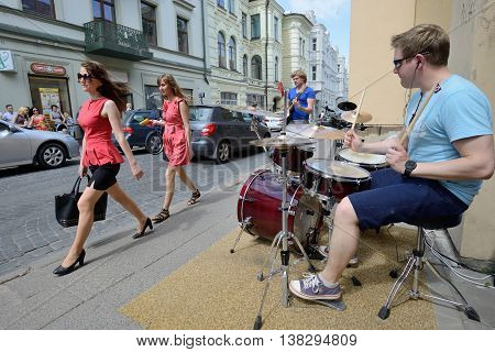 VILNIUS, LITHUANIA - MAY 18: Unidentified musician play drums and guitar in Street music day on May 18, 2013 in Vilnius. Its a most popular event on May in Vilnius, Lithuania