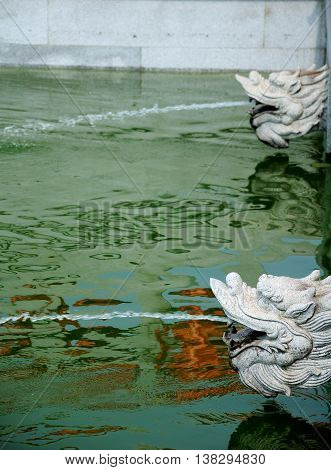 Stone Chinese dragon water fountains at the Baoshan Buddhist Temple in Baoshan district of shanghai China.