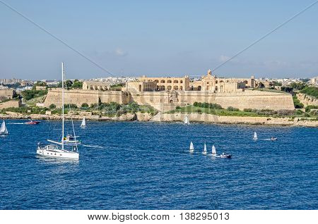 Valletta Malta - November 8 2015: View of Fort Manoel - an example of Baroque architecture - on Manoel Island in Gzira from the sea. Fort Manoel is located to the north west of Valletta and commands Marsamxett Harbour and the anchorage of Sliema Creek.