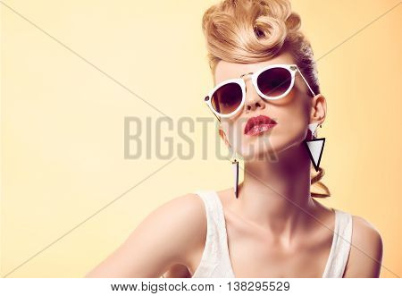 Fashion portrait Hipster Model woman, Stylish hairstyle. Fashion Makeup. Blond sexy Model, Trendy Glamour sunglasses. Playful girl cheeky emotion. Unusual Creative.Party disco mohawk hairstyle