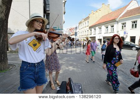 VILNIUS, LITHUANIA - MAY 18: Unidentified musician play violin in Street music day on May 18, 2013 in Vilnius. Its a most popular event on May in Vilnius, Lithuania