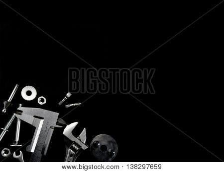 different instrument mechanic lying on a black background