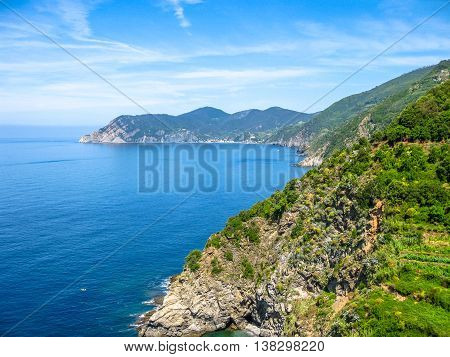 Ligurian coast view from the popular trail between Vernazza and Monterosso al Mare. Landscape of Cinque Terre, National Park and Unesco Heritage, Italy.