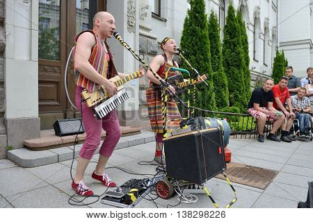 VILNIUS, LITHUANIA - MAY 18: Unidentified musician play guitar in Street music day on May 18, 2013 in Vilnius. Its a most popular event on May in Vilnius, Lithuania
