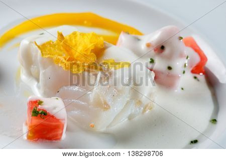 closeup of a fish with tomato dish