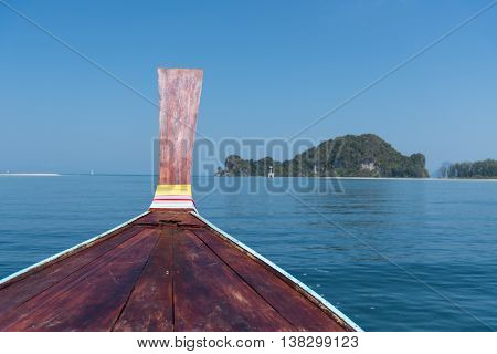 Thai Wooden Head Longtail Boat Heads Toward