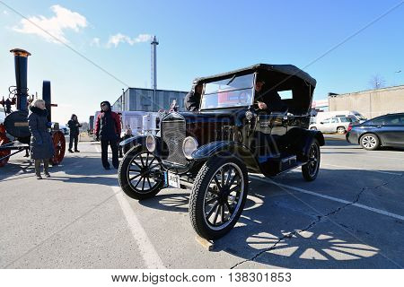 KAUNAS, LITHUANIA - MAR 23: Antique car show in a traditional flea market in second biggest Lithuanian city - Kaunas, on March 23, 2013 in Kaunas, Lithuania