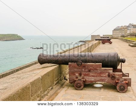 Ancient gun on Intramuros's walls. Saint Malo, Brittany, France