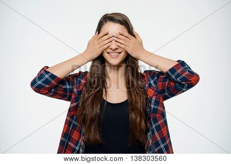 Dissapointed young girl covering her eyes. Over white background