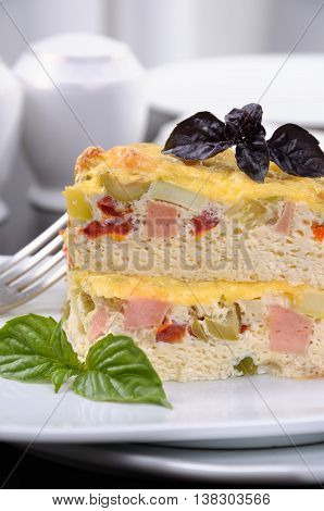 Omelet with vegetables and ham for breakfast close up