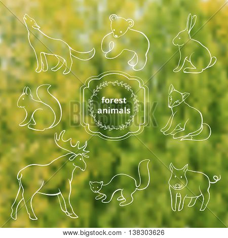 painted forest animals in the blurry green background
