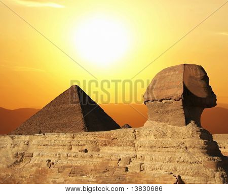 Egyptian sphinx and pyramid on sunset