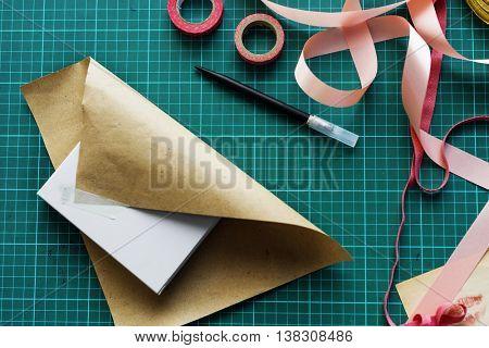 Gift Wrap Present Paper Cutter Handmade Grid Concept