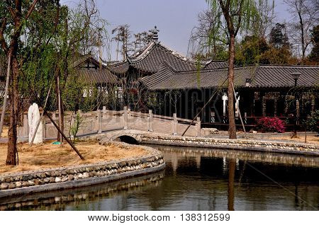 Sheng Pin China - March 7 2013: Footbridge and lagoon in the gardens at the General Yin Chang Heng Historic House Museum