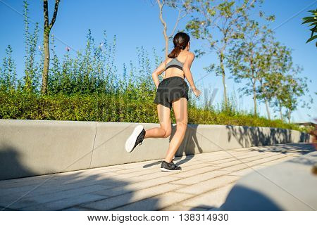 The back view of woman running
