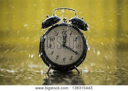 Rain is falling on the analog clock.