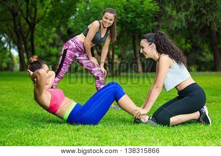 Sportswomen Exercising In Park