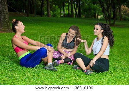Girlfriends In Sportswear Having Fun On Grass