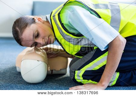 Female paramedic during cardiopulmonary resuscitation training in hospital