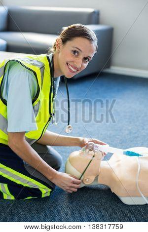 Portrait of female paramedic during cardiopulmonary resuscitation training in hospital