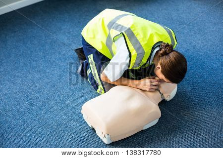 Paramedic during mouth-to-mouth resuscitation training in hospital