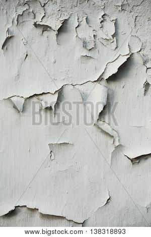 Outdoor wall with a white peeling paint.