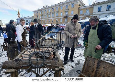 VILNIUS, LITHUANIA - MARCH 2: Unidentified people trades traditional metal decoration in annual traditional crafts fair - Kaziuko fair on Mar 2, 2013 in Vilnius, Lithuania
