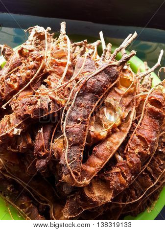 close up dry tamarind fruit for cooking