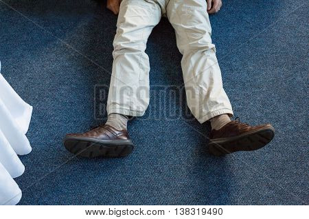 Unconscious man lying on rug at home